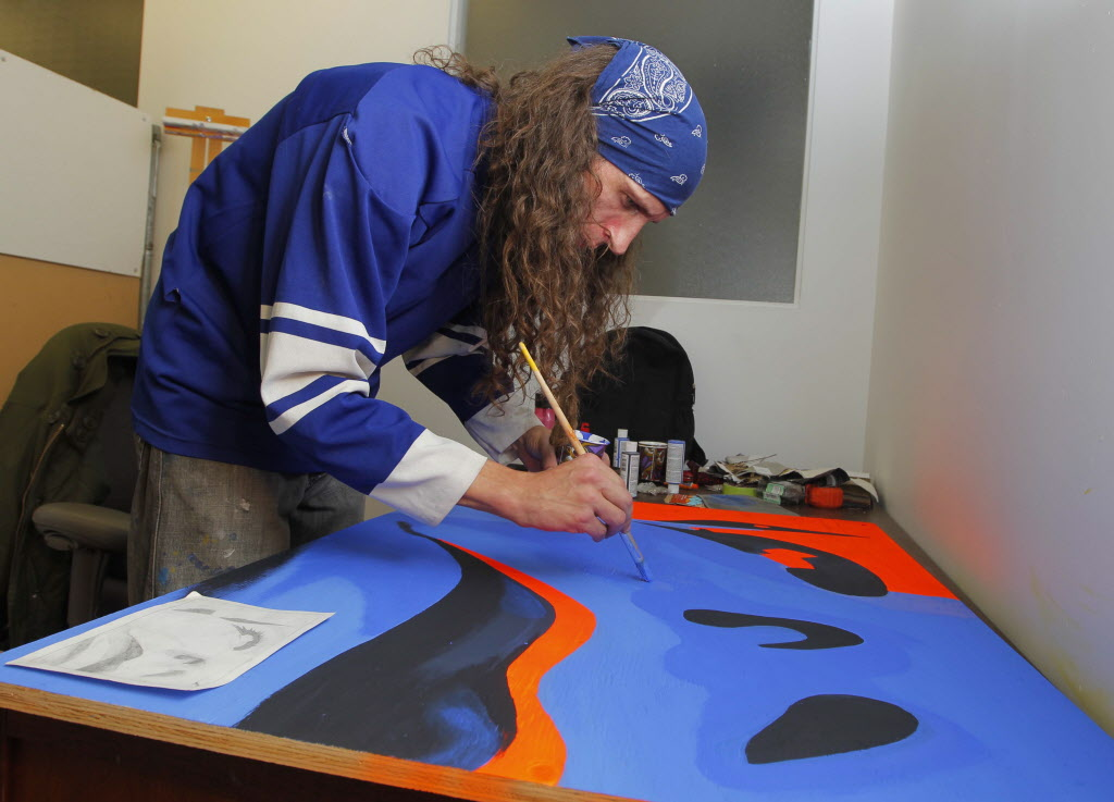 Marcus Bauer paints up a storm during the 24-hour art-a-thon at Winnipeg's Artbeat Studio. (Boris Minkevich / Winnipeg Free Press)