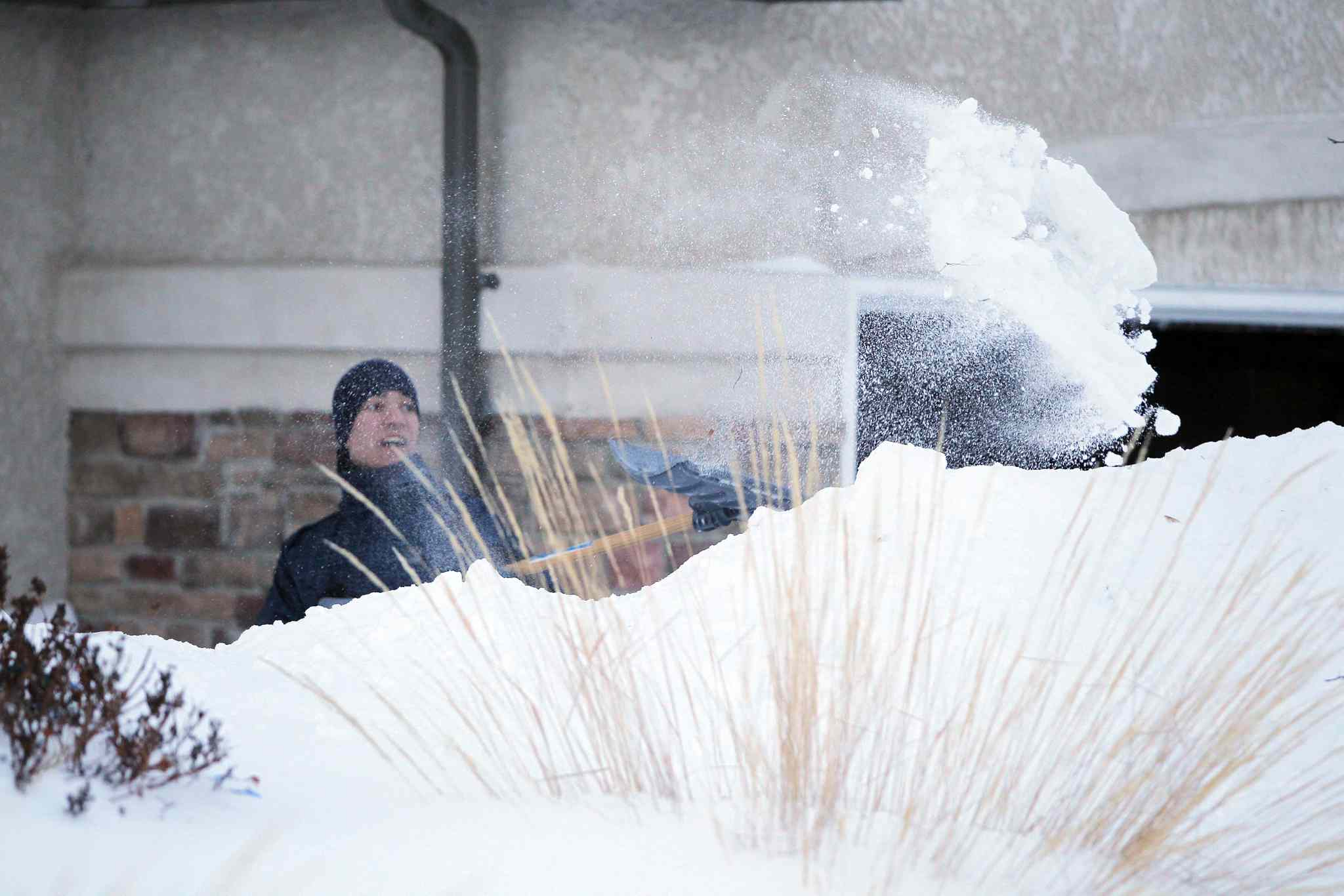 Darren Melanson shovels snow on Lyndale Drive in mid-February. Though Winnipeg is infamous for its harsh winters, this one has already been colder and snowier than many in recent memory.