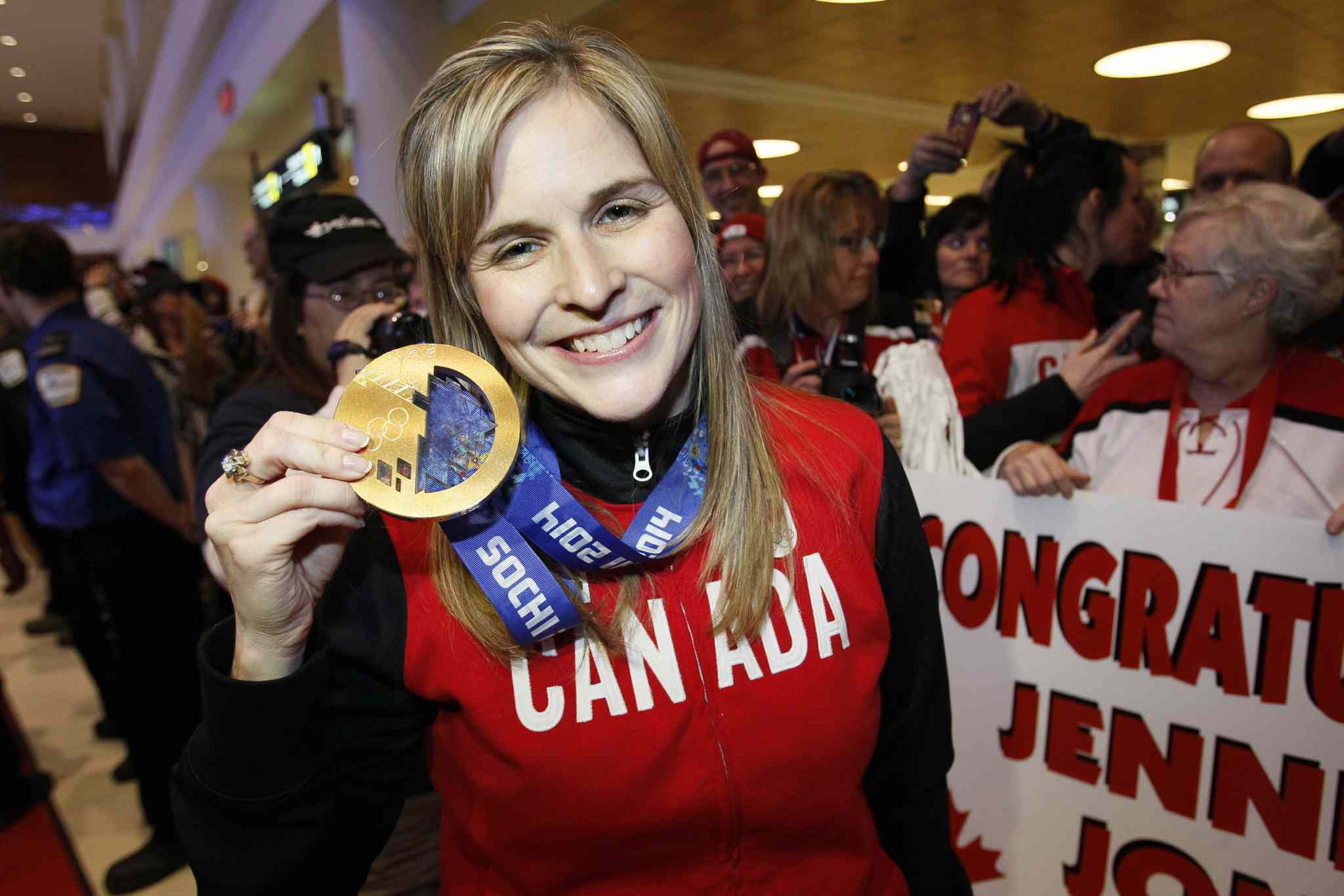 Jennifer Jones was all smiles as she held up her gold medal.