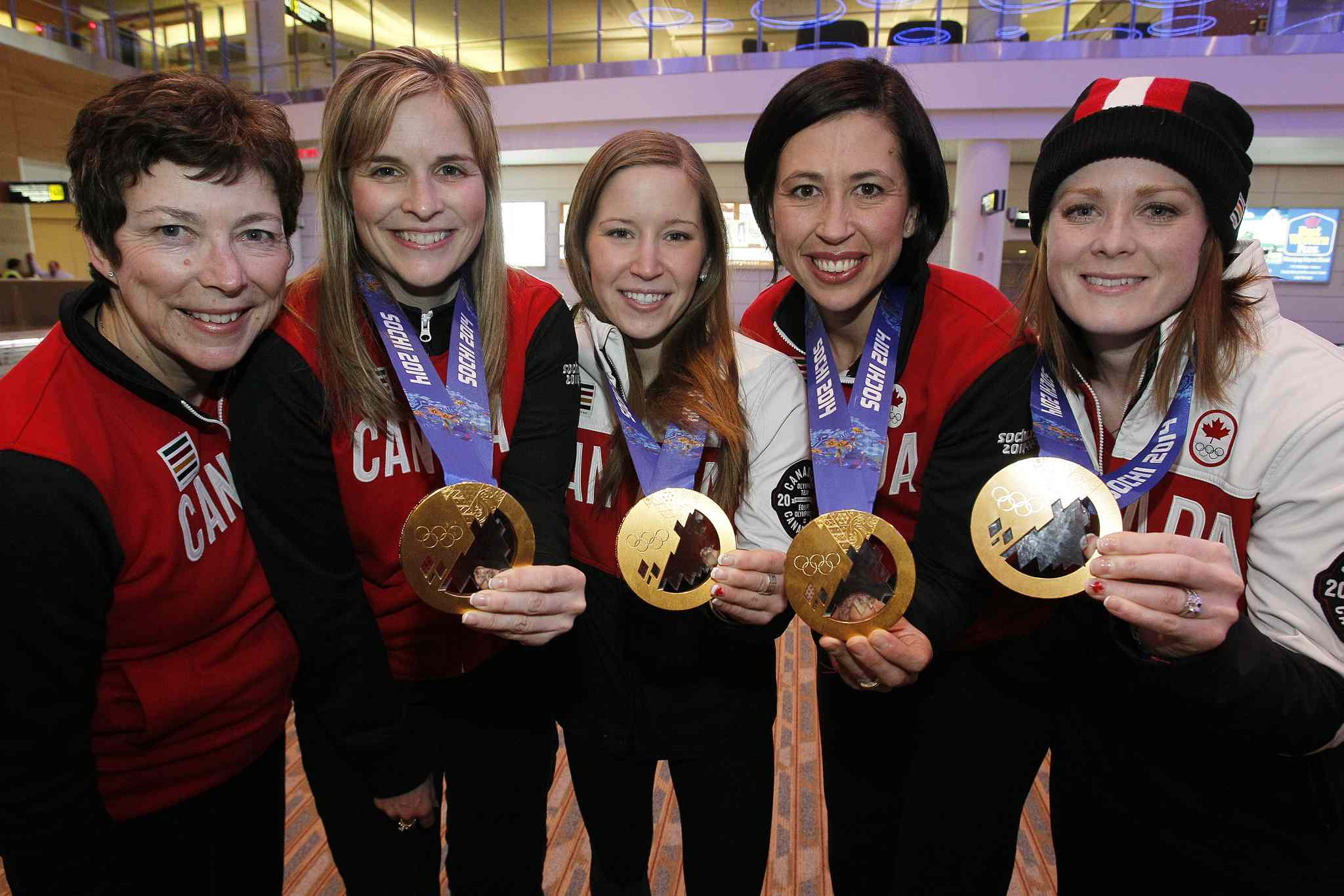 The Jones rink show off their well-earned hardware at the Winnipeg airport last night.