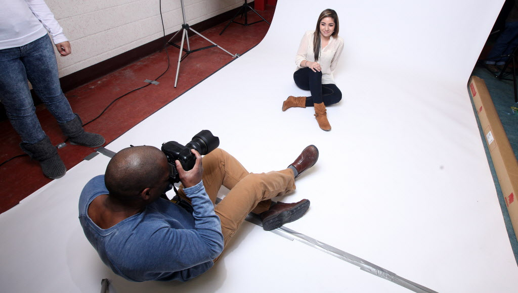Chantel Holmes poses for a portrait photographer. She is a mom and hopes to become a welder.