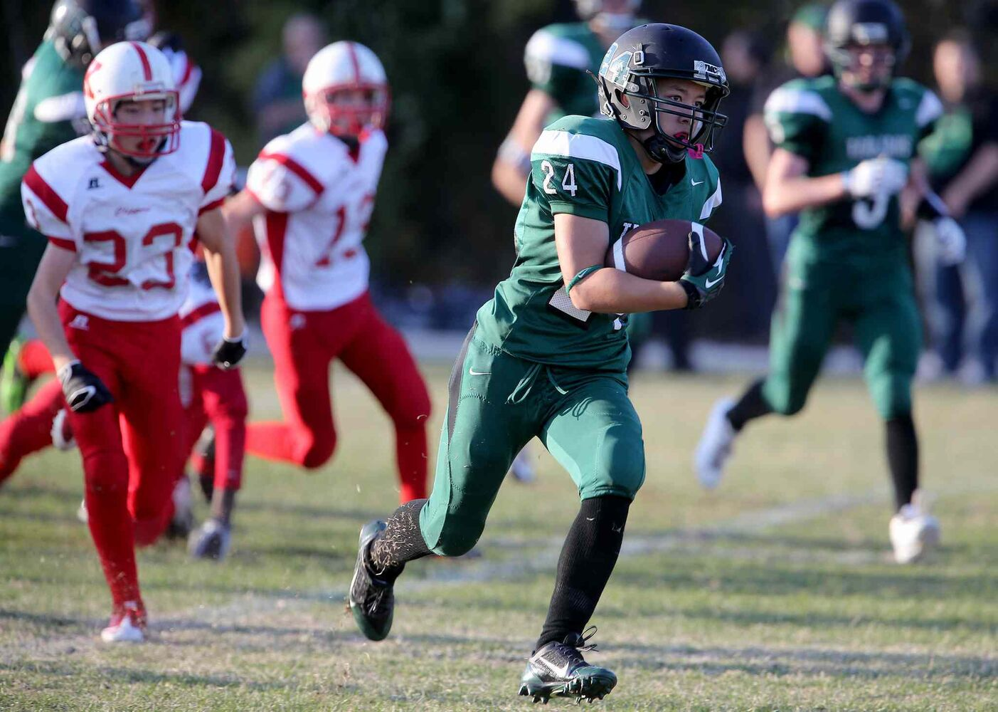 Vincent Massey Trojans' Steinn McIntosh carries the ball against the Kelvin Clippers. (TREVOR HAGAN / WINNIPEG FREE PRESS)