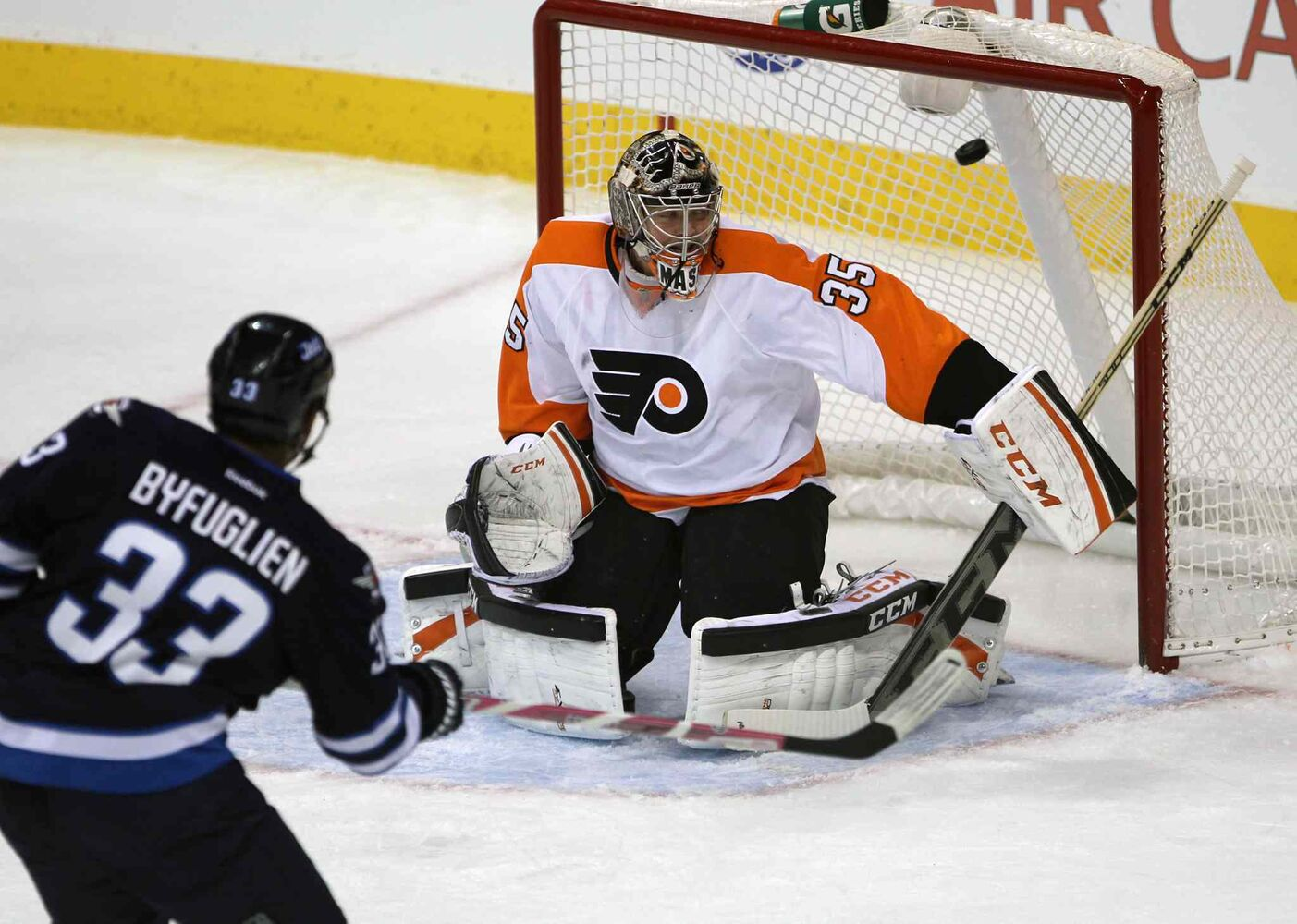 Winnipeg Jets Dustin Byfuglien shoots one by Philadelphia Flyers goaltender Steve Mason during the first period. (JOE BRYKSA / WINNIPEG FREE PRESS)