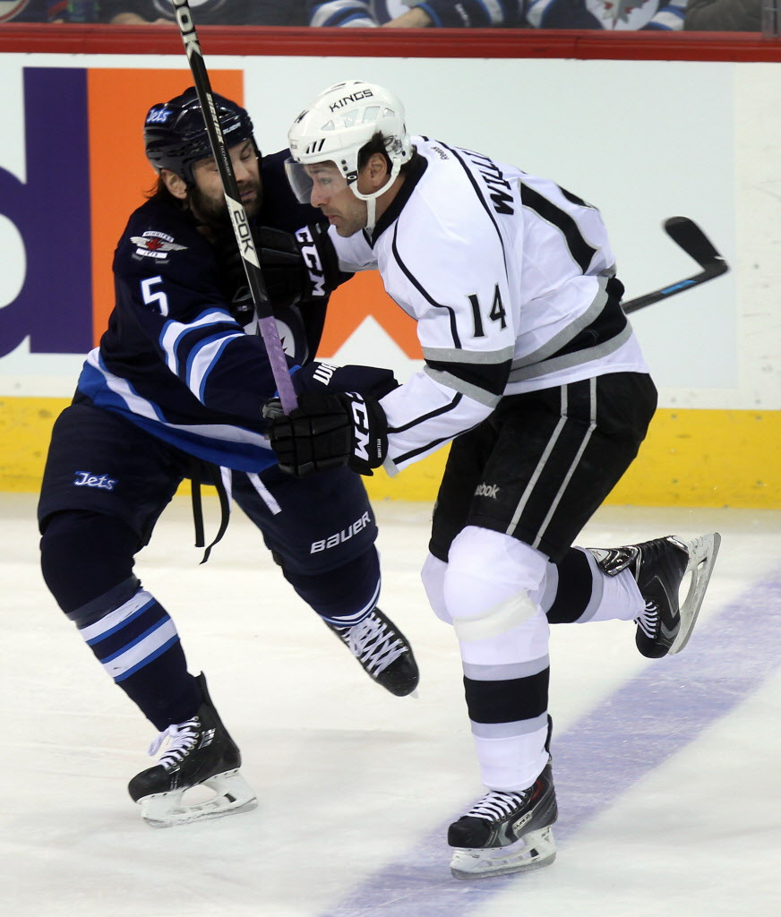 Winnipeg Jets Mark Stuart takes Los Angeles Kings Justin WIlliams out of the play in first period action.
