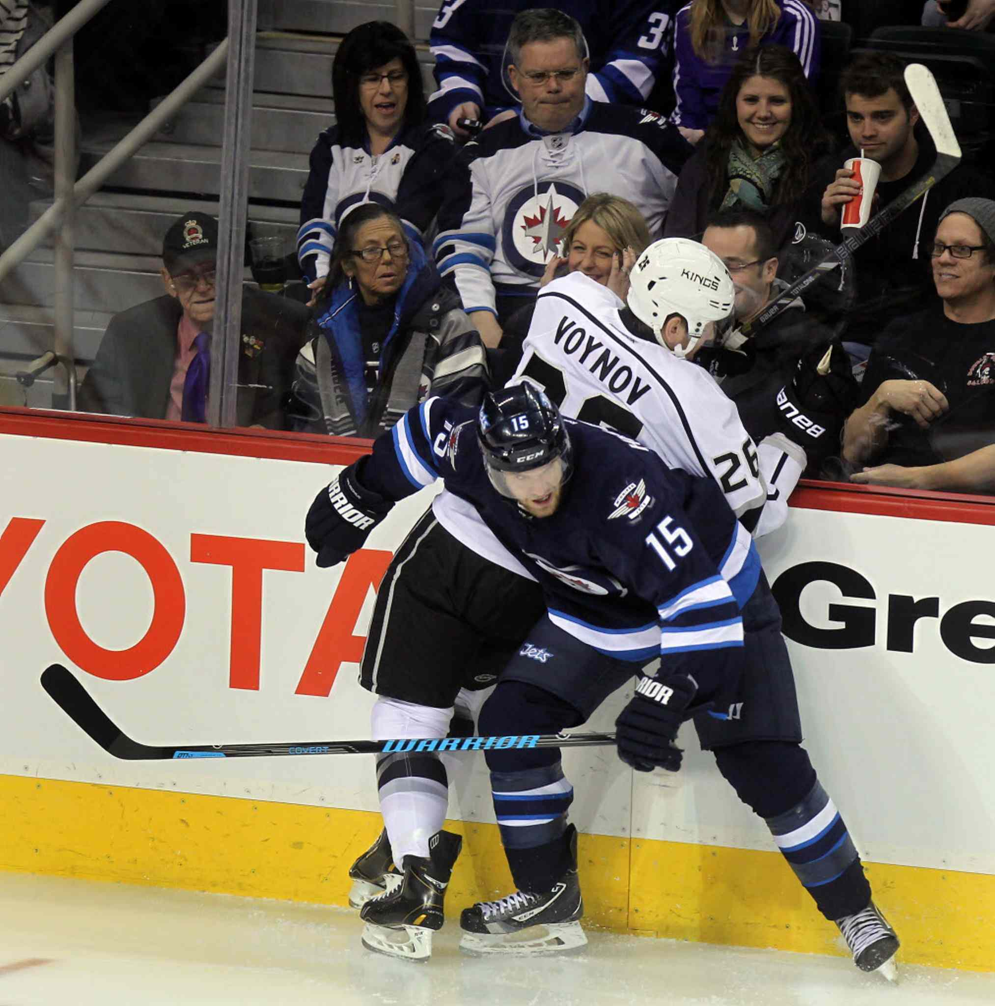 Andrew Ladd corners Los Angeles King Slava Voynov in first period action at the MTS Center Thursday.