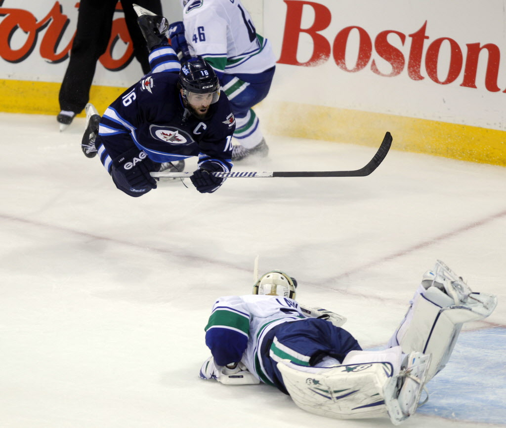 Jets capt. Andrew Ladd also tries to score in the third with no success.    (BORIS MINKEVICH / WINNIPEG FREE PRESS)
