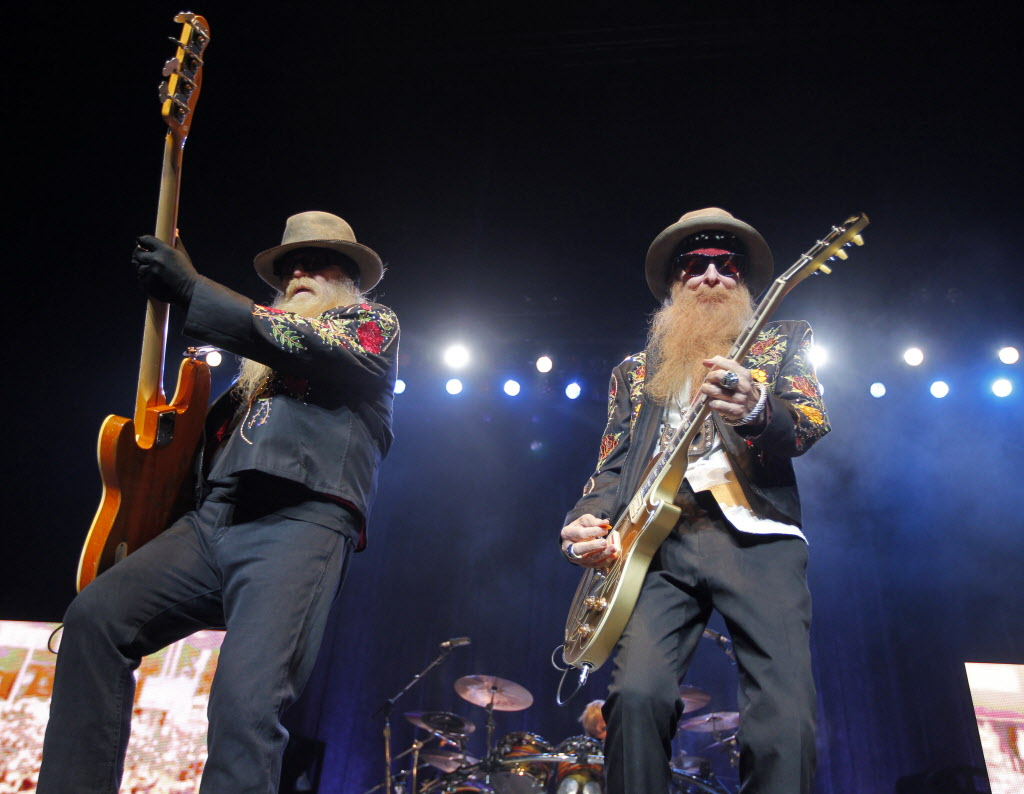 Dusty Hill (bass), Frank Beard (drumming), and Billy Gibbons (guitar) perform to an eager MTS Centre crowd.  (BORIS MINKEVICH / WINNIPEG FREE PRESS )