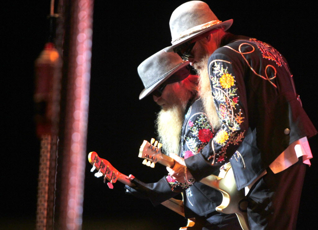 Dusty Hill (bass) and Billy Gibbons (guitar) pull off some coordinated moves.