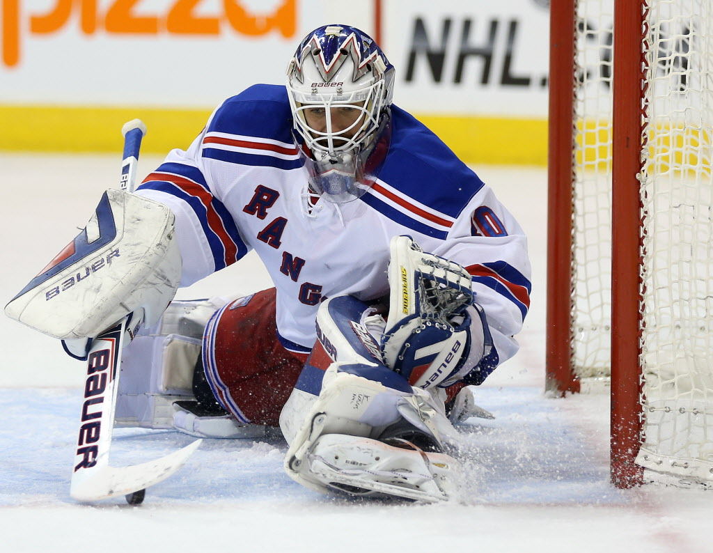 New York Rangers' goaltender Henrik Lundqvist (30) makes a save against the Winnipeg Jets' during second period NHL hockey action.