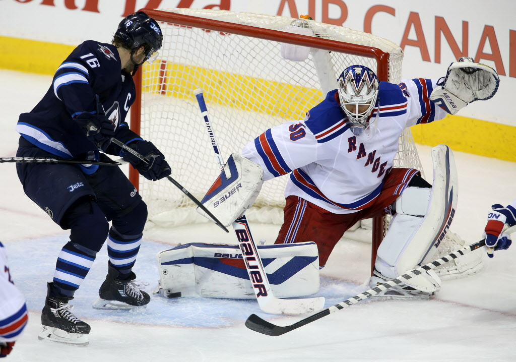 Winnipeg Jets' Andrew Ladd (16) is stopped by New York Rangers' goaltender Henrik Lundqvist (30) during third period NHL hockey action at MTS Centre in Winnipeg, Friday, March 14.