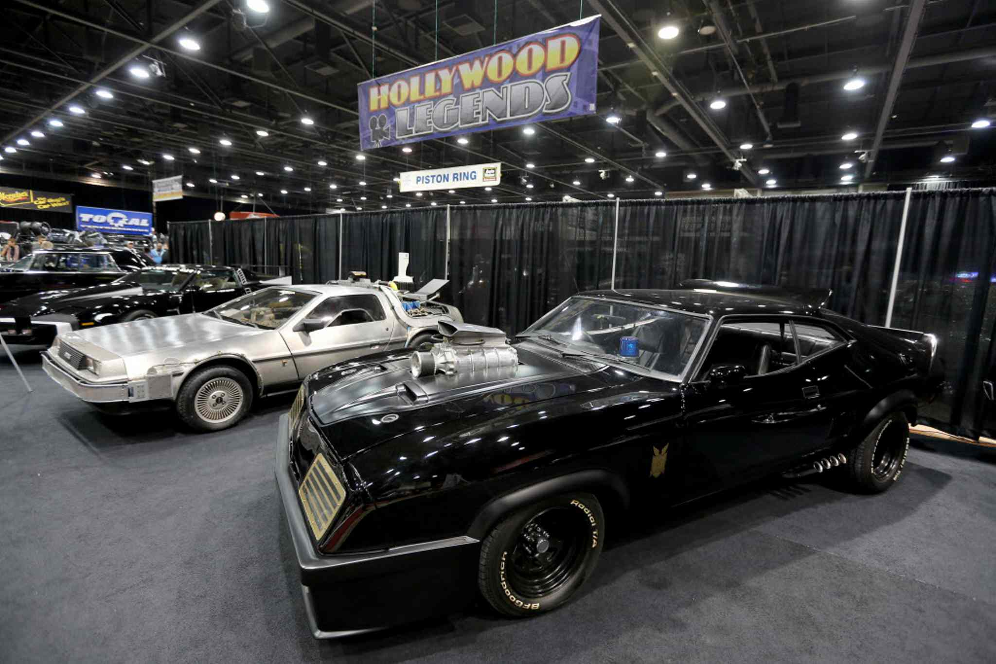A Delorean from the Back to the Future movie series alongside a Ford Falcon from the Mad Max series.