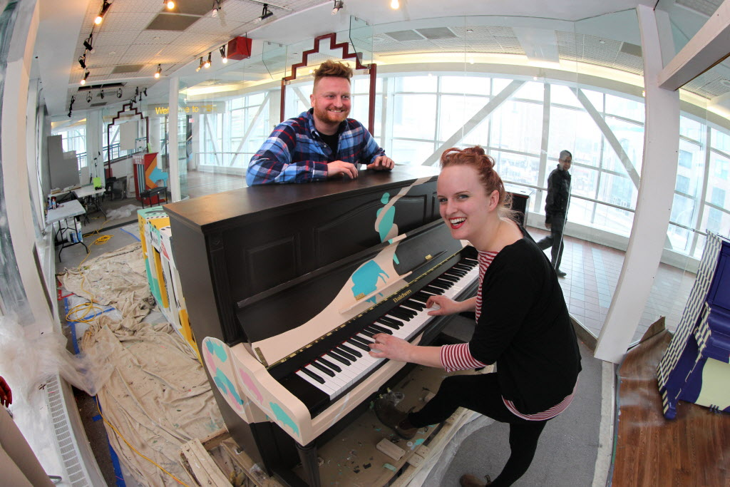 Chloe Chafe and Patrick Skene, visual artists at Studio 393, which is located in the overhead walkway between The Bay and Portage Place. (Ruth Bonneville / Winnipeg Free Press)