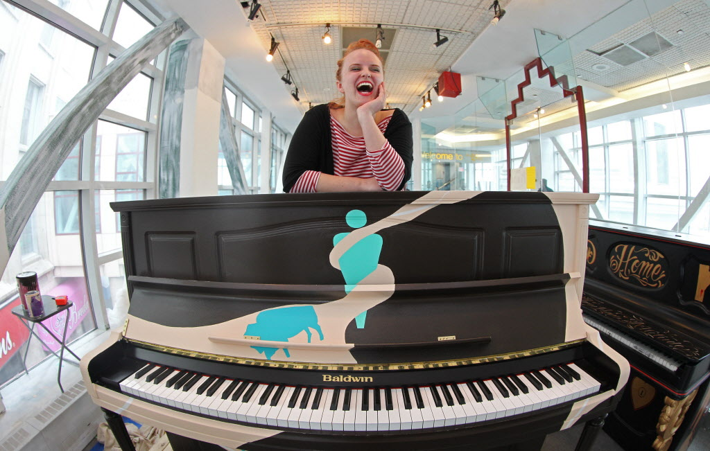 Chloe Chafe, a visual artist, at Studio 393 located in the overhead walkway between The Bay and Portage Place, displays her Juno themed piano she painted. This will be one of the 7 pianos placed in a public space in downtown Winnipeg to be used and enjoyed at will by Winnipegers.