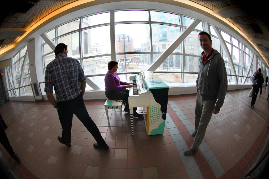 Erna Wiens plays one of the donated pianos on the overhead walkway between Portage Place and The Bay. Seven donated pianos were fixed up and painted by artists at Studio 393 and are being placed in various public spaces throughout downtown Winnipeg.