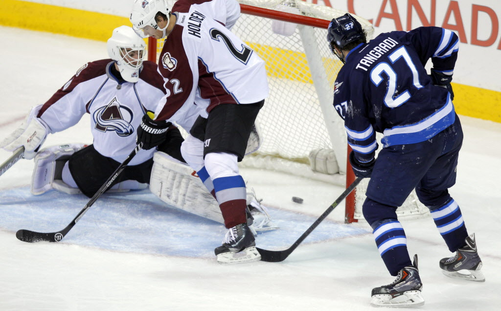 Winnipeg Jets' Eric Tangradi scores a goal in the first period.