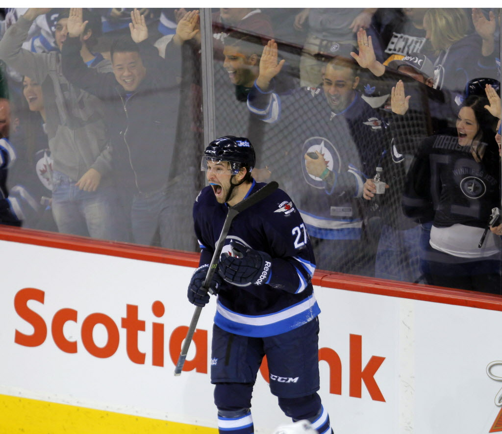 Winnipeg Jets' Eric Tangradi celebrates his goal on the Avalanche in the first period.