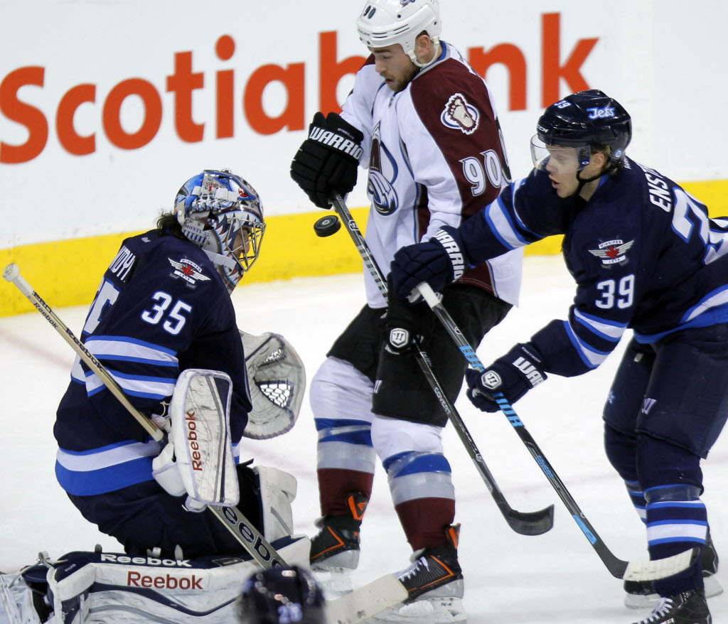 Jets goalie Al Montoya, Avalanche #90 Ryan O'Reilly, and Jets #39 Tobias Enstrom fight for the puck as the Jets take on the Avalanche tonight at MTS Centre.   (BORIS MINKEVICH / WINNIPEG FREE PRESS  )