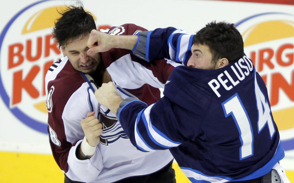 Anthony Peluso battled Avalanche #58 Patrick Bordeleau in the second period.  (BORIS MINKEVICH / WINNIPEG FREE PRESS  )