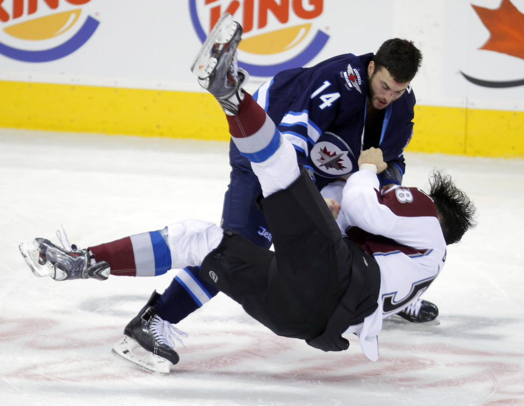 Peluso and Bordeleau ended up tussling on the ice before they were finally broken up.  ( BORIS MINKEVICH / WINNIPEG FREE PRESS)