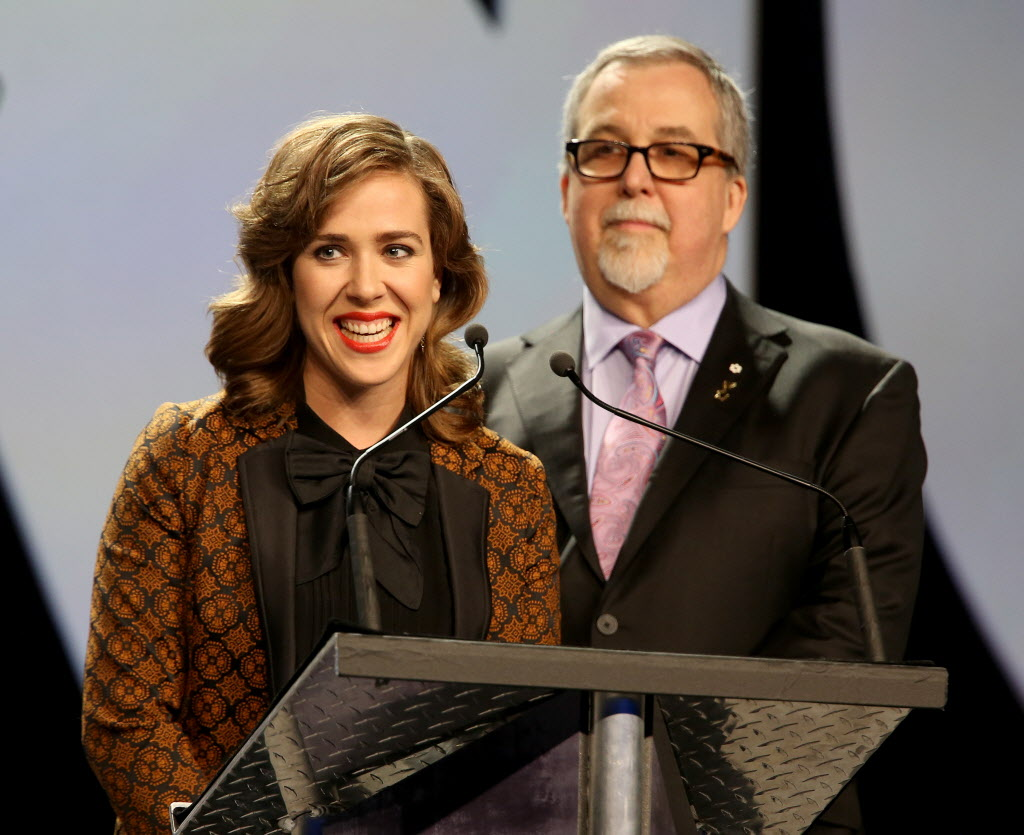 Juno host Serena Ryder and Deane Cameron present Frank Davies with the Walt Grealis Special Achievement Award at the 2014 Juno Gala.  (TREVOR HAGAN / WINNIPEG FREE PRESS)