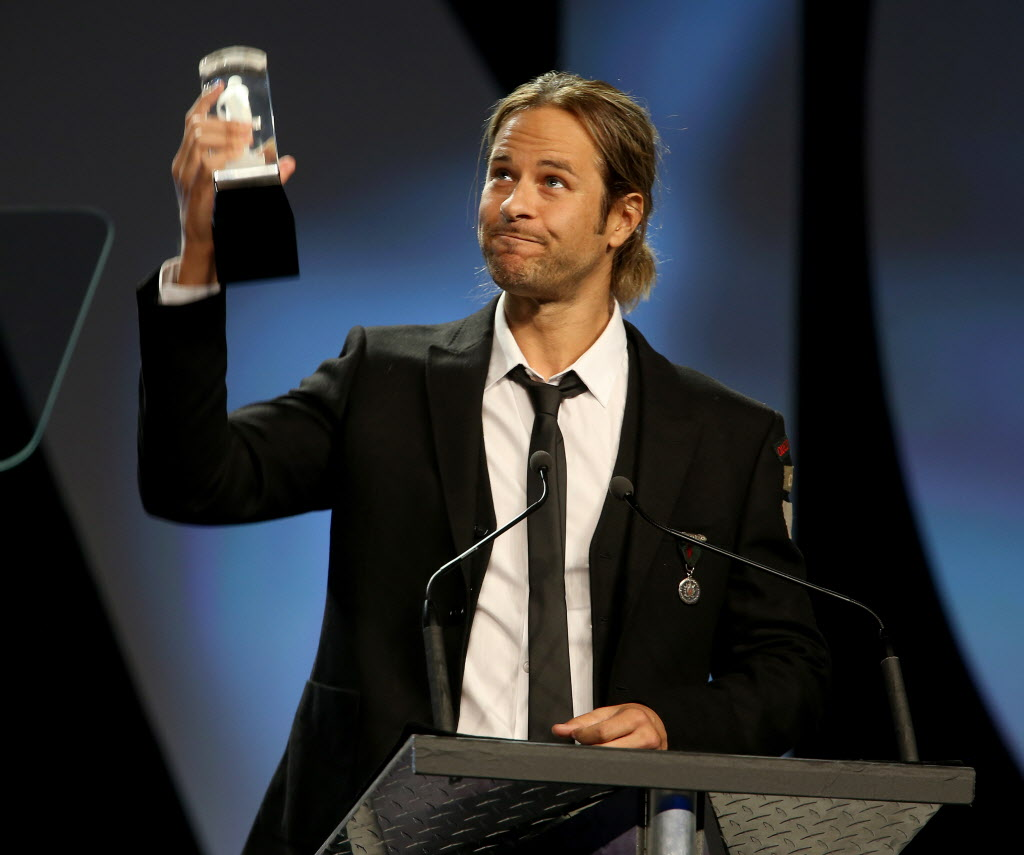 Trevor Guthrie accepts the Juno after he and Armin van Buuren won the Juno for Dance Recording of the Year. (TREVOR HAGAN / WINNIPEG FREE PRESS)