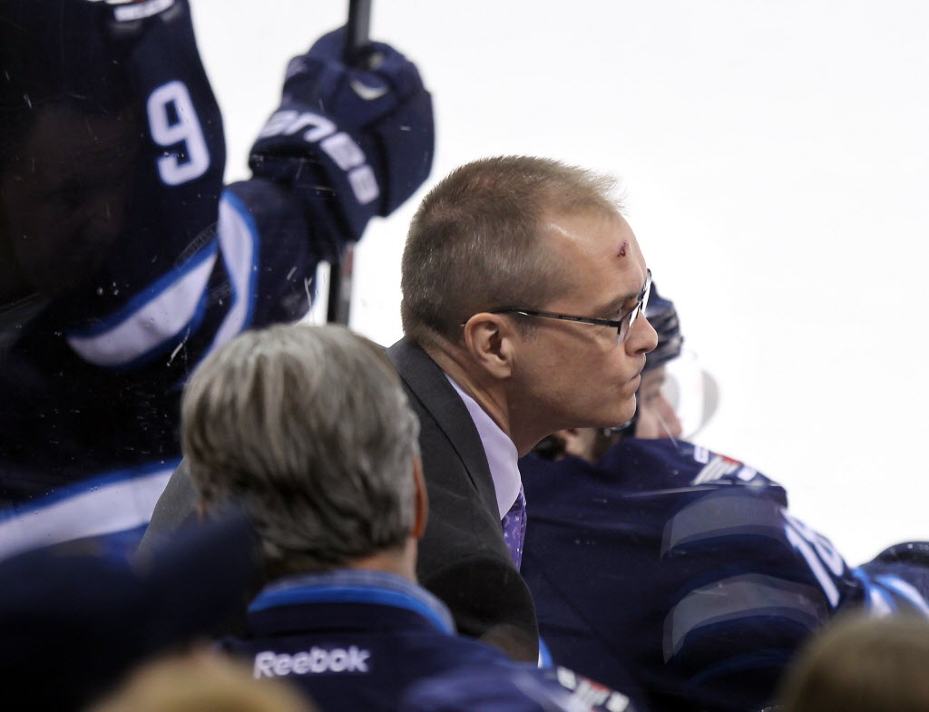 Winnipeg Jets Coach Paul Maurice sports a gash on his forehead after a rogue puck hit him in the face in the first period.  (Phil Hossack / Winnipeg Free Press)