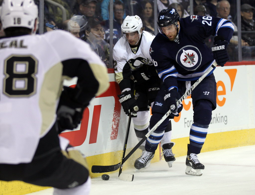 Winnipeg Jet Blake Wheeler works against Pittsburgh Penquin Matt Niskanen Thursday.