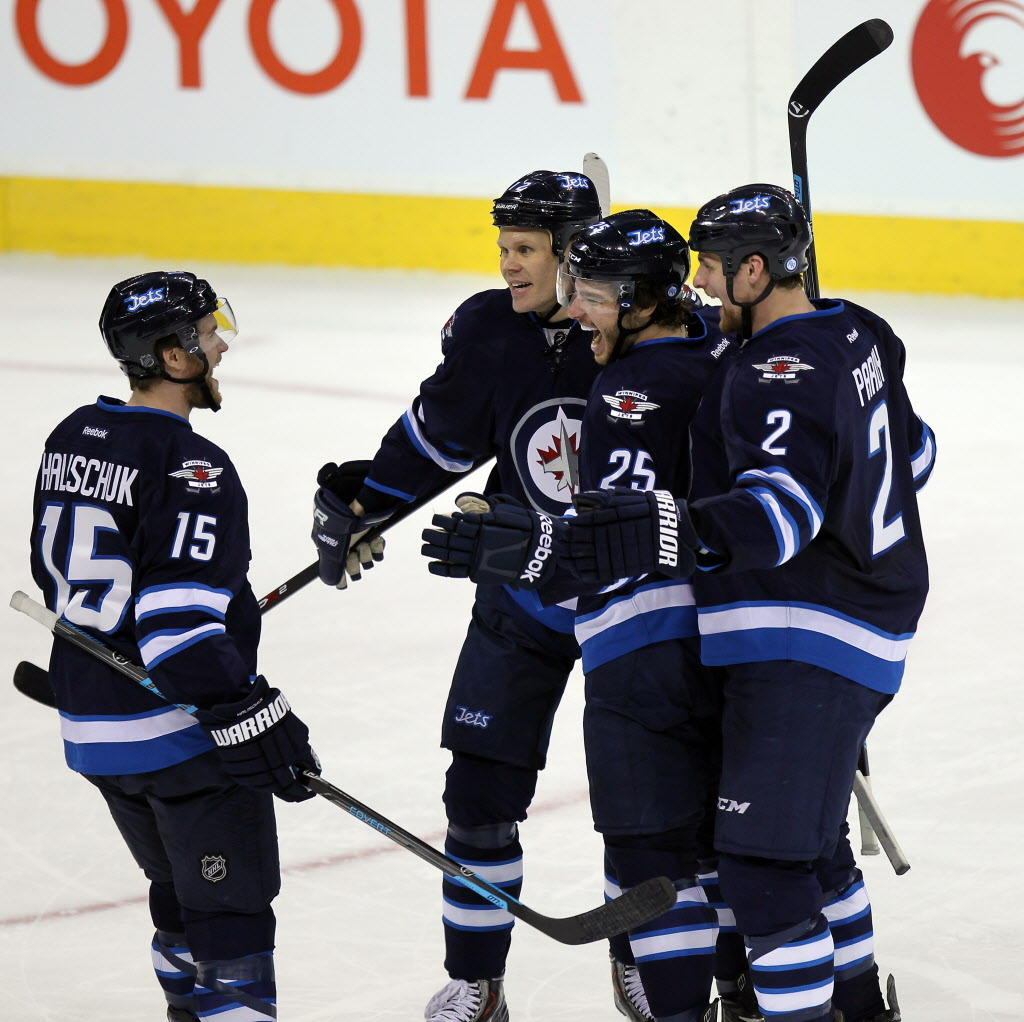 Left to right Winnipeg Jets Matt Halischuk, Ollie Jokinen, Zach Redmond and Adam Pardy celebrate Redmond's go-ahead goal  Thursday during second period action. Pardy assisted on the point.
