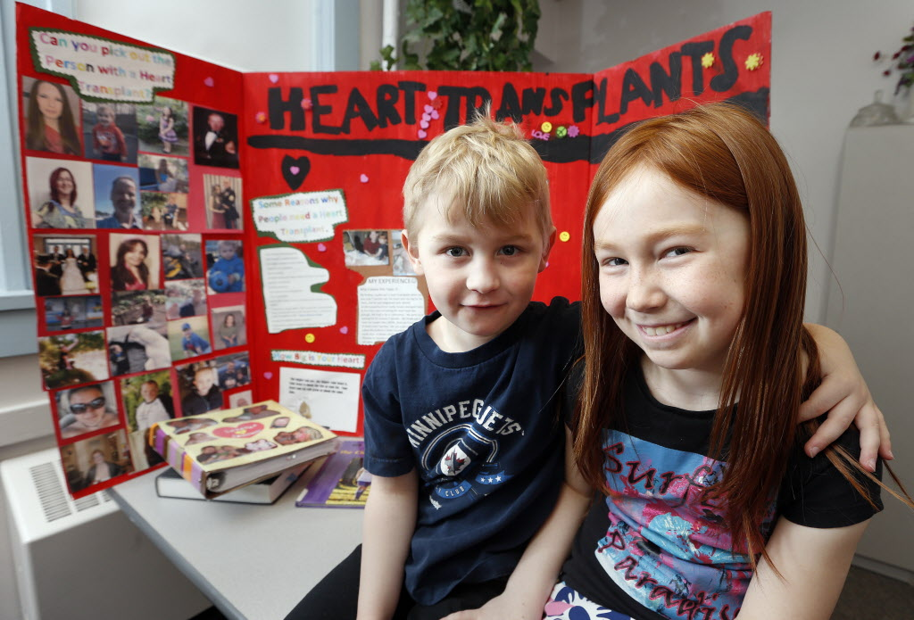 Belle Syrett with brother Jayden Strattner-Brown and her project detailing his transplant.