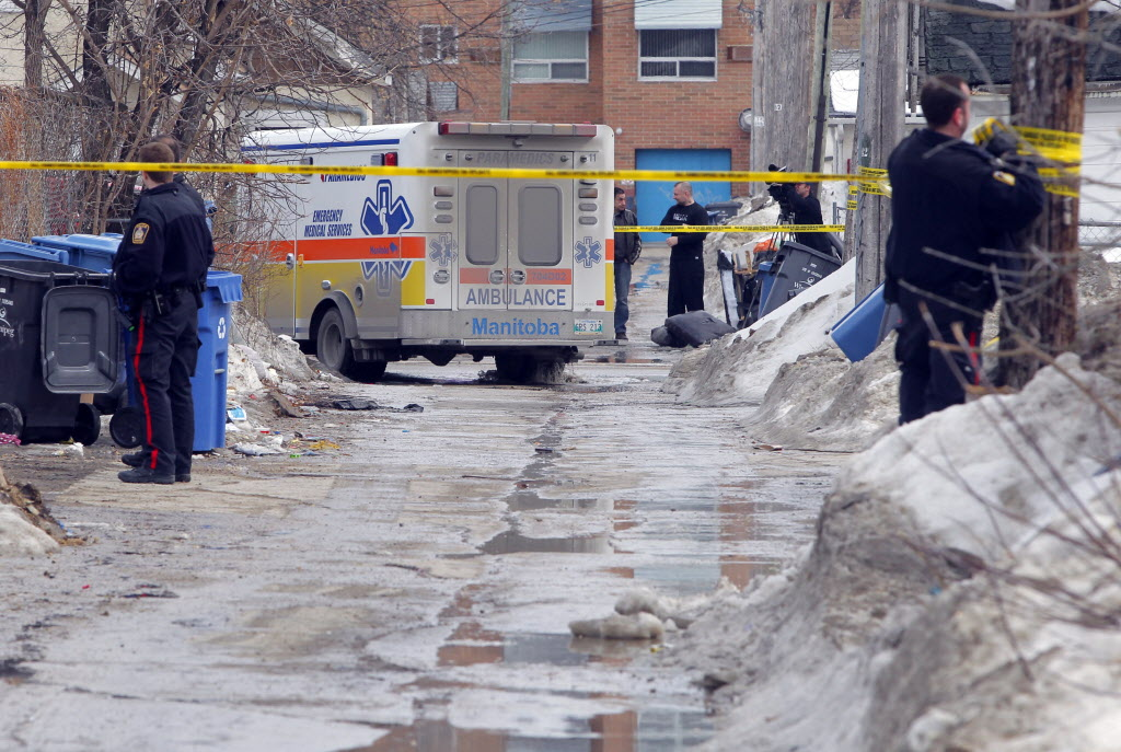 Police at the shooting scene in the 600 block of Manitoba Avenue near McKenzie Street Monday.