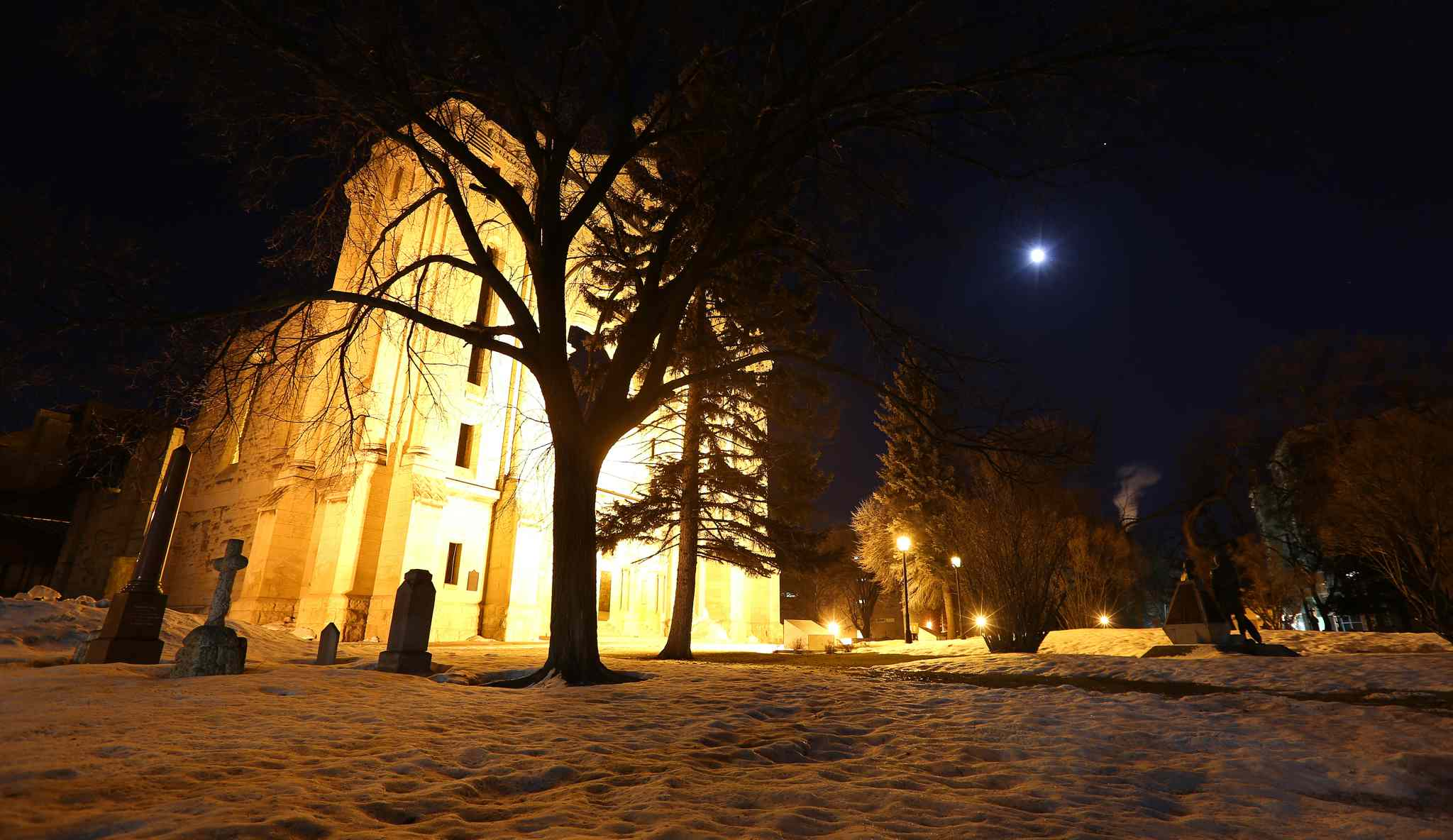The moon is seen over the Saint Boniface Cathedral.  Tuesday's eclipse was the first of four eclipses this year and the first of four total lunar eclipses this year and next.