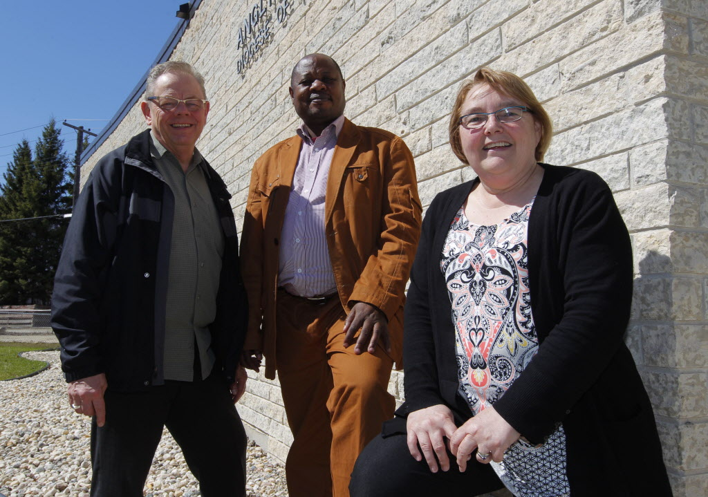 Lutheran clergy, from left, Rev. Larry Ulrich, Bishop Ruben Ngozo and Bishop Elaine Sauer meet in Winnipeg. Ngozo, who hails from Cameroon, is visiting Manitoba congregations and passing on his observations on religious matters.