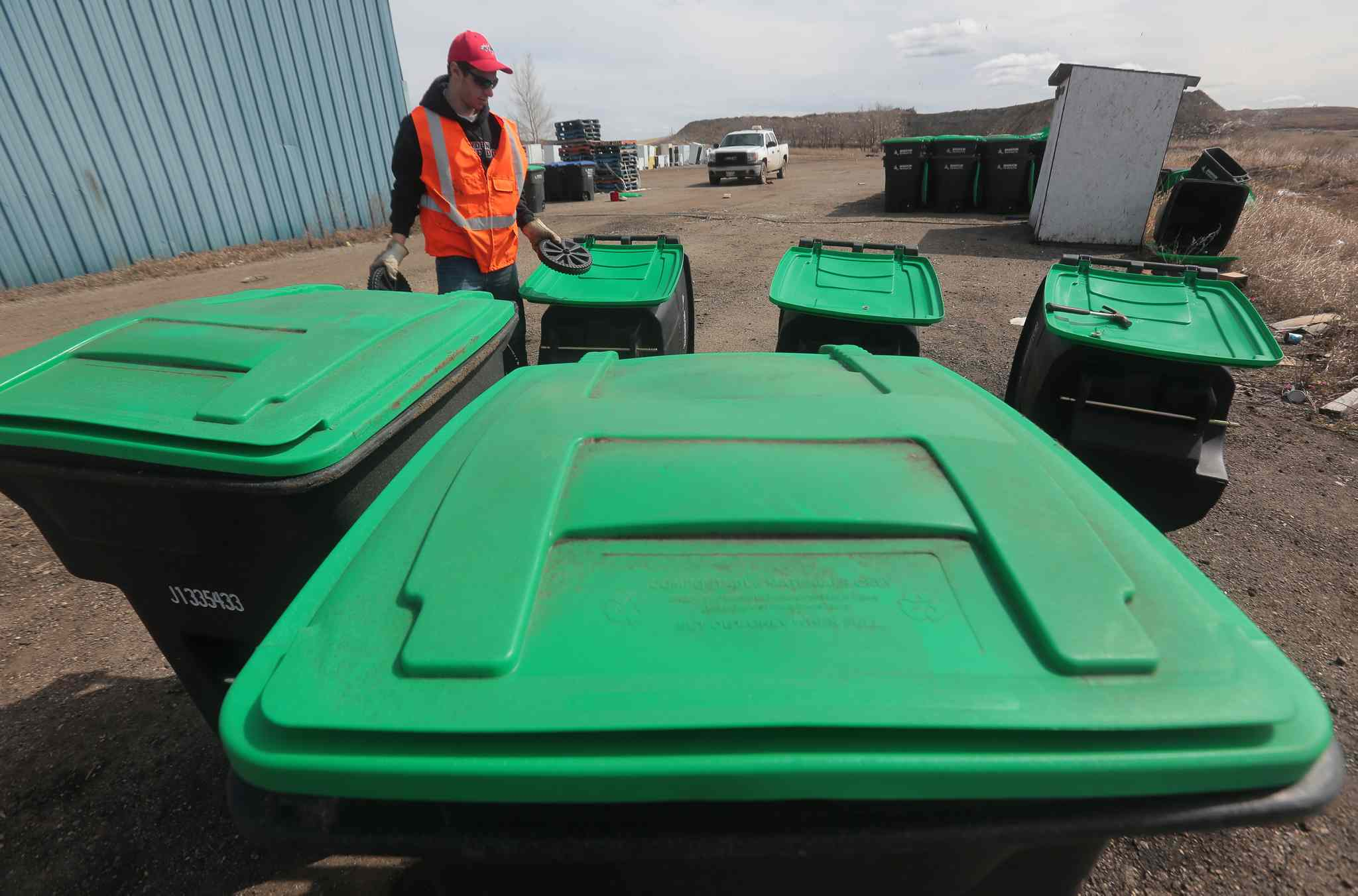 Summer employee Chris Sitko assembles new composting bins at the Eastview Landfill in Brandon.