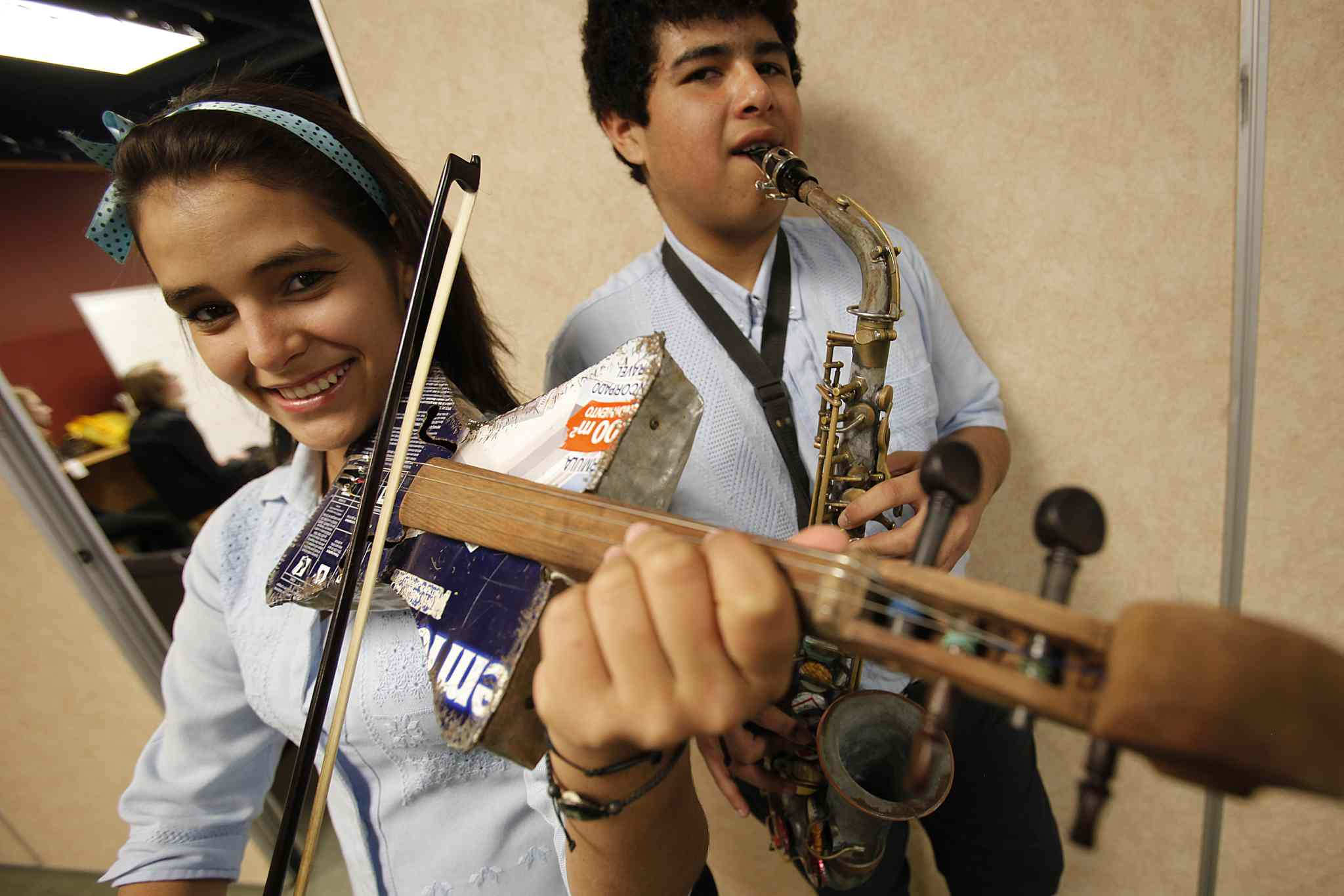John Woods / Winnipeg Free Press Teenage musicians Tania Vera and Tobias Armoa from Cateura, Paraguay, were in Winnipeg to play their instruments made from trash found on a landfill, in a concert at North Kildonan Mennonite Brethren Church Sunday.