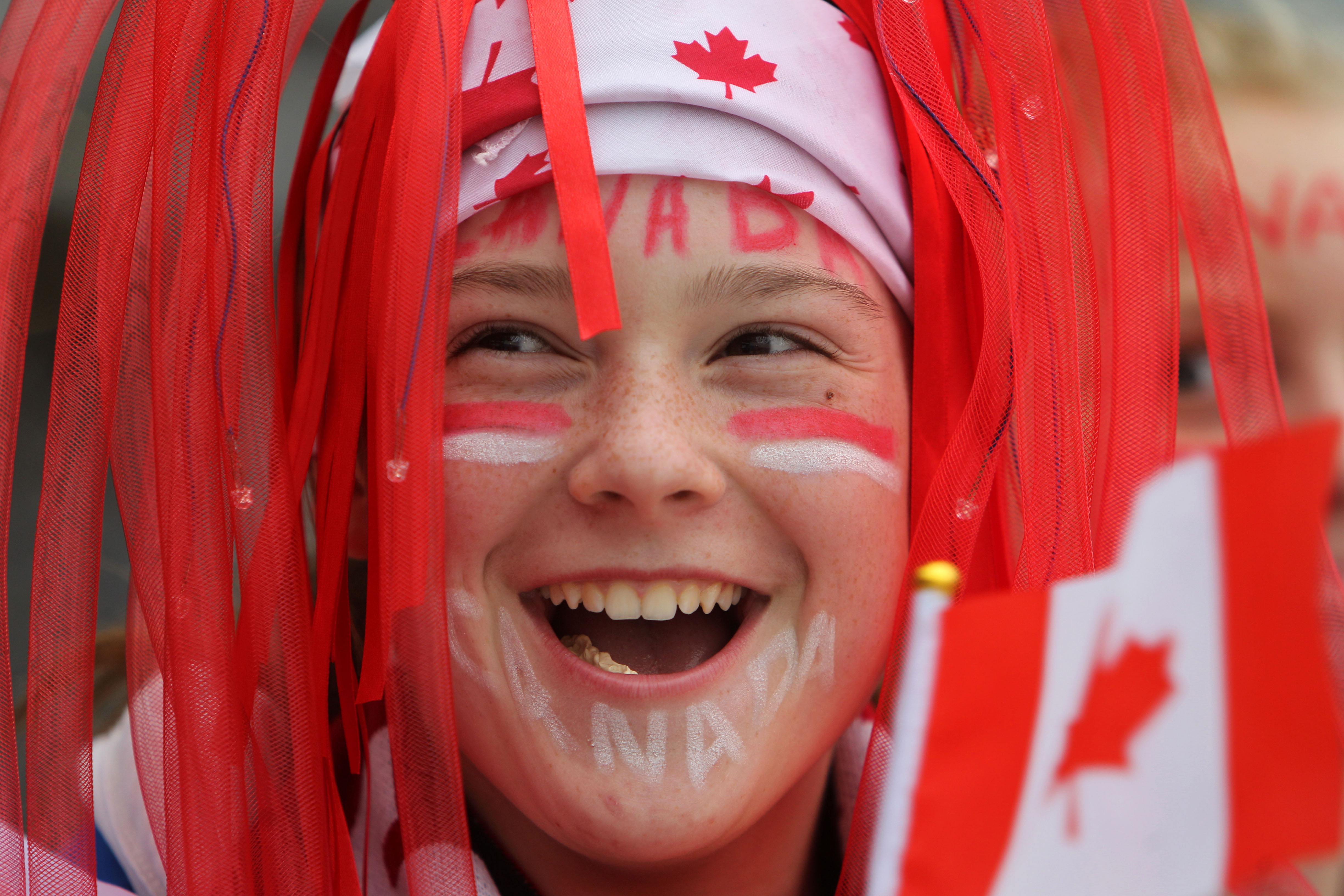 Young soccer fan Jadyn Friesen cheers on Team Canada at their friendly match against Team USA at Investors Group Field.