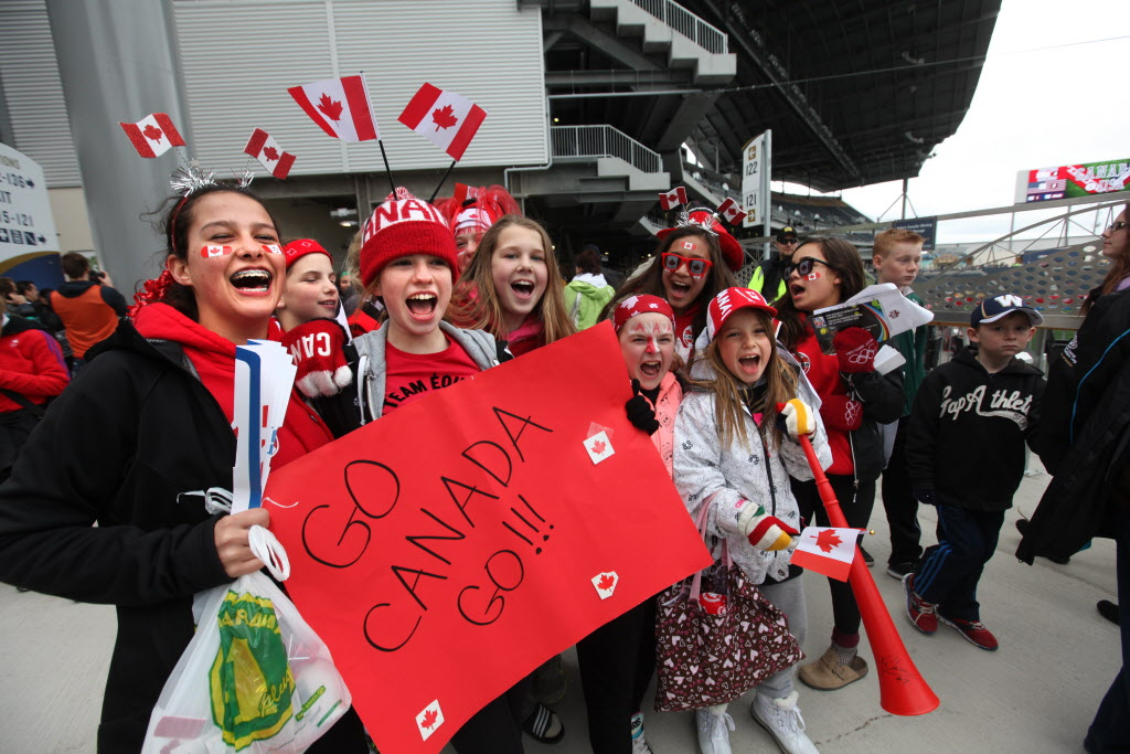 Young Manitoba provincial team soccer players start cheering for their favourite team on the steps of the stadium Thursday just before Canada takes on Team USA at the women's international soccer match at Investors Group Field.    (Ruth Bonneville / Winnipeg Free Press)