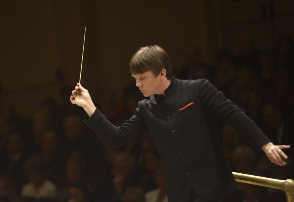 Maestro Alexander Mickelthwate leads the orchestra Thursday.