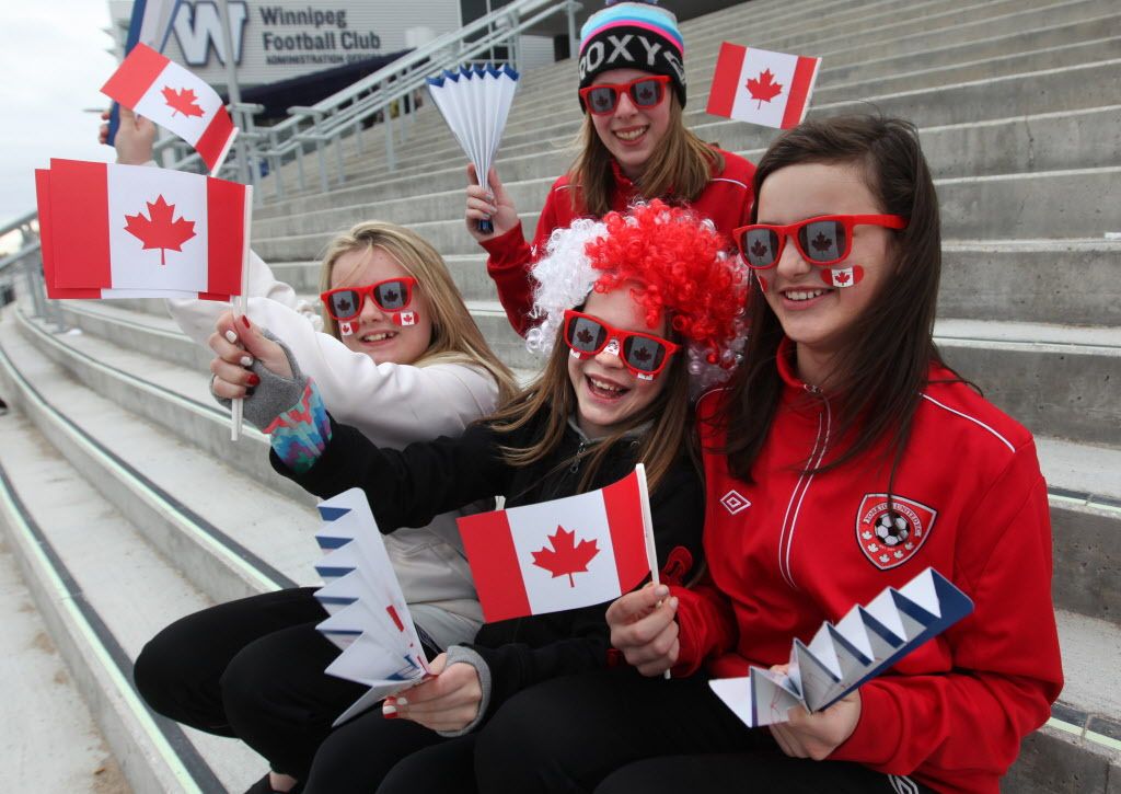 Young soccer players from Yorkton, Sask. start cheering for their favourite team on the steps of the Investors Group Field stadium Thursday before the   Canada v USA women's soccer friendly.  From right, Sarah Nelson, Sara Becker, Maddi Stevenson and Hannah Adam.   (Ruth Bonneville / Winnipeg Free Press)