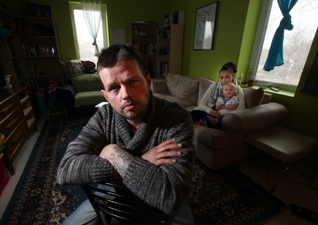 Joshua Key, in his St. Norbert home with his wife, Alexina, and their one-year-old daughter, Eva, says he recently reapplied for a work permit.