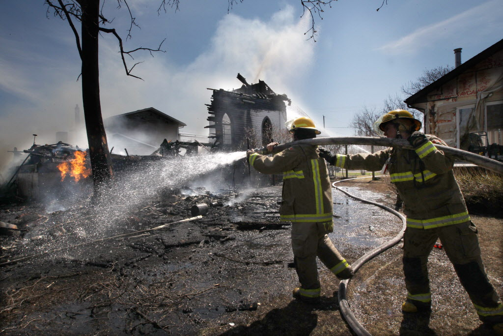 The Starbuck United Church in Starbuck, Manitoba caught fire and is a total loss Friday. Firefighters keep the fire under control near 3 p.m. to prevent it from spreading to homes on either side of the structure.