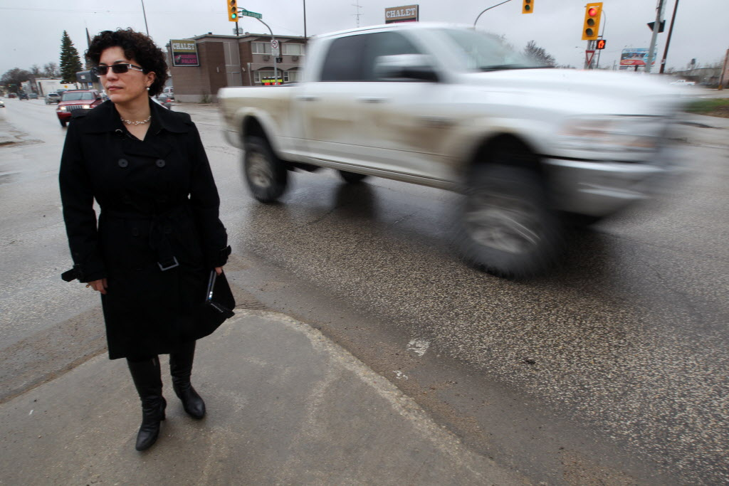 Jeannette Montufar, a traffic engineer at University of Manitoba, points out problems at the intersection of Marion and Archibald.