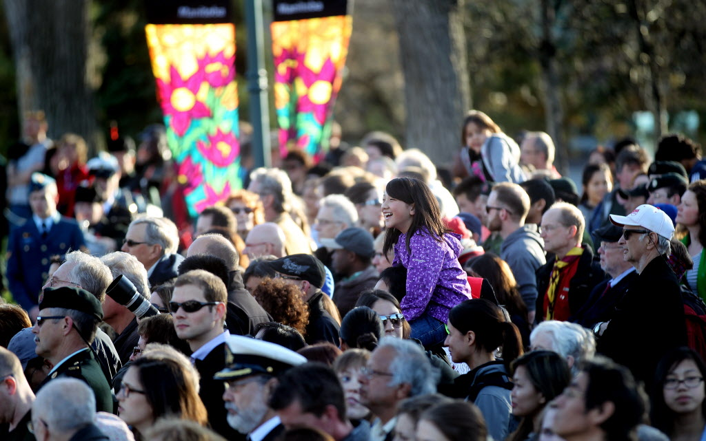 An enthusiastic crowd waitied patiently for an appearance of Prince Charles and Camilla at the Legislature Wednesday evening. (Phil Hossack / Winnipeg Free Press)