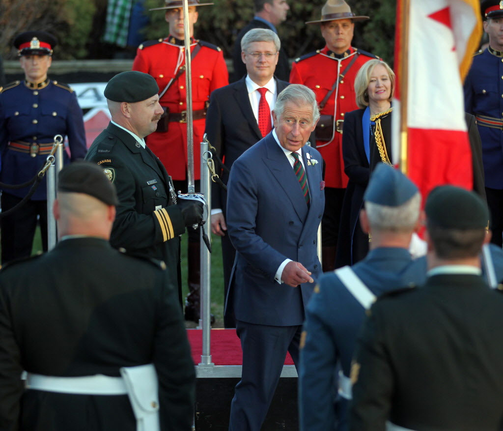 Prince Charles makes his way through to inspect the honour guard after a walkabout at the legislature.  (Phil Hossack / Winnipeg Free Press)