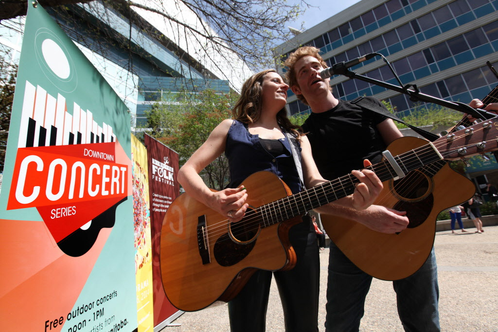 Winnipeg musicians Keith and Renée perform Tuesday at Air Canada Park during the kickoff for this year's Downtown Concert Series.