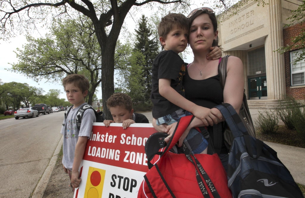 Nola Hunstad, with her three children, Alex, Nick and Ethan, (from left), isn't happy a proposed city bylaw reducing speed limits near schools doesn't include major streets such as Inkster Boulevard, which runs past her kids' school.