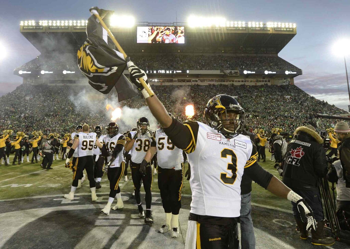 Hamilton Tiger-Cats linebacker Marc Beswick (3) leads his team onto the field at the Grey Cup Sunday. (Frank Gunn / The Canadian Press)