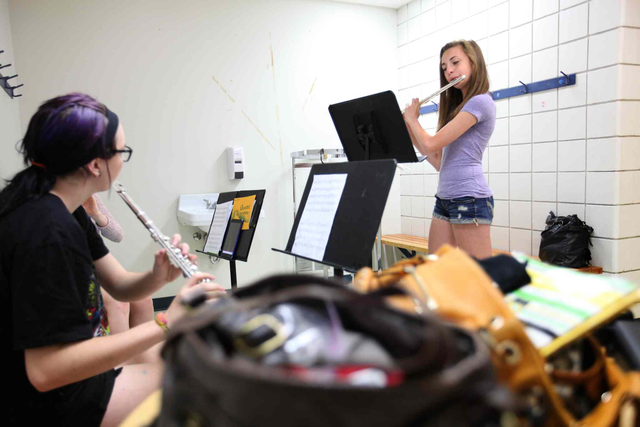 Aby plays flute in a small group during band class.