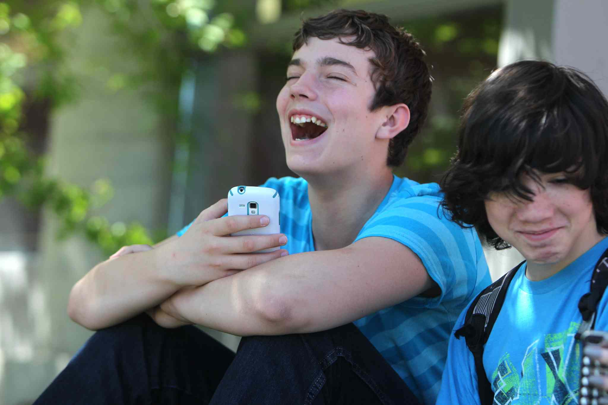 Quinn and Thomas hang together outside the front of Glenlawn Collegiate during a spare.