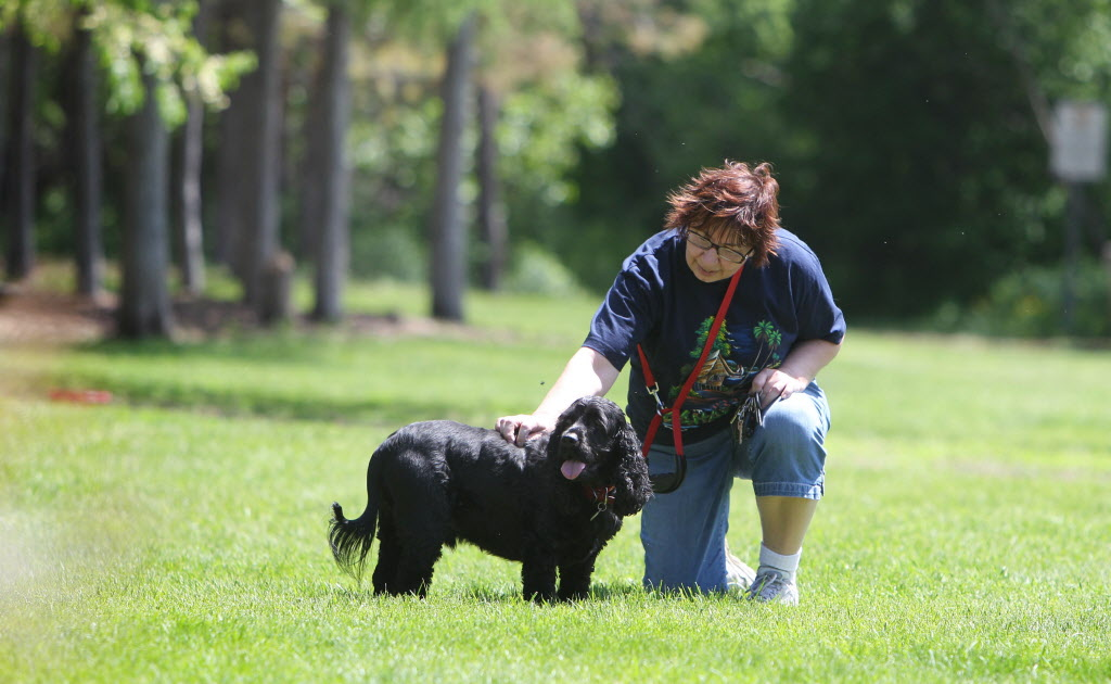 Colleen Farnworth pets her dog after a walk in Little Mountain Park Tuesday.