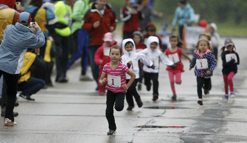 Emma Pauls, 5, wins the Mini Mites race at the Manitoba Marathon at the University of Manitoba, Sunday, June 15, 2014.  (Trevor Hagan / Winnipeg Free Press)